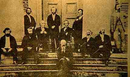Chancellor Waddel, Professor Wheat and other faculty on the steps of the Lyceum in the late 1860s